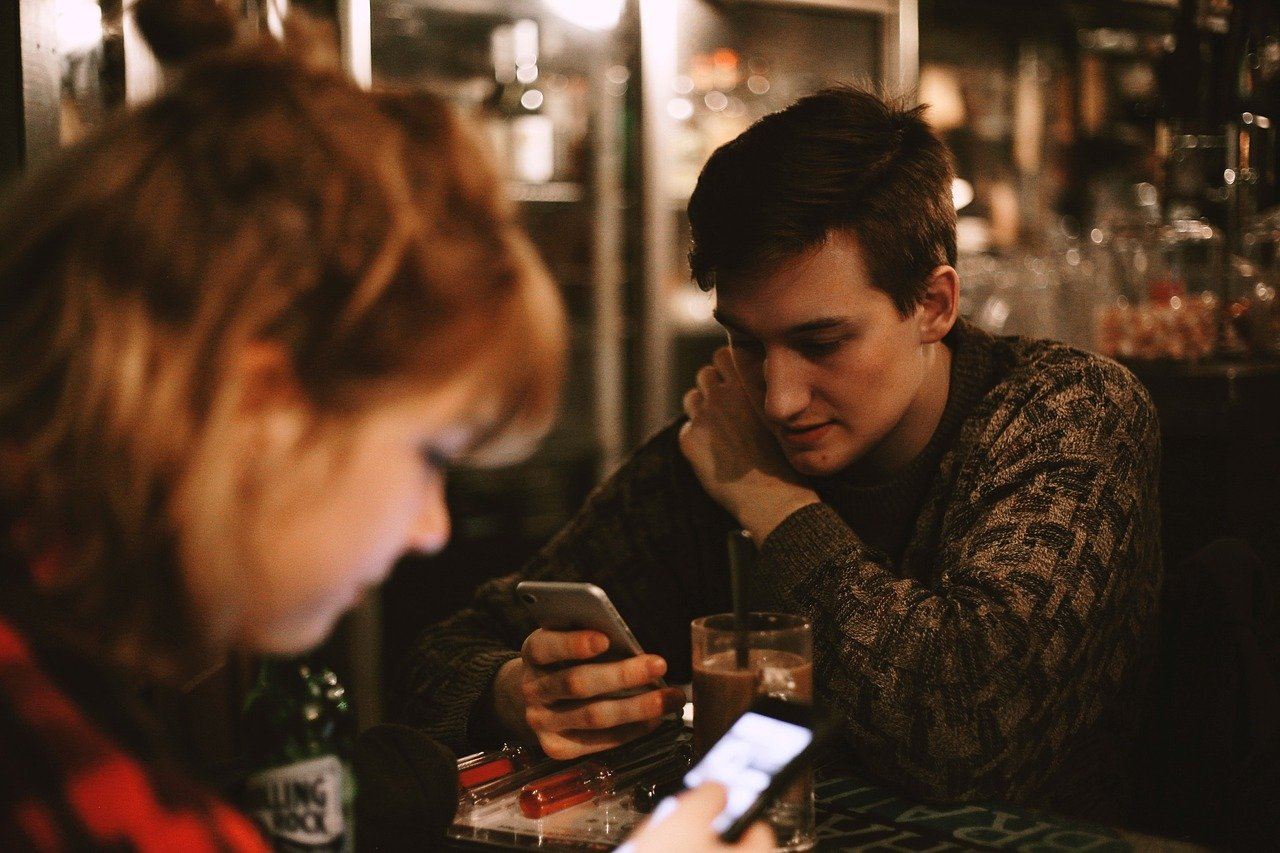 People with smartphone at restaurant