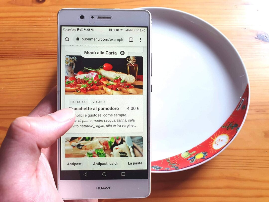 Digital menu on smartphone with table and dish