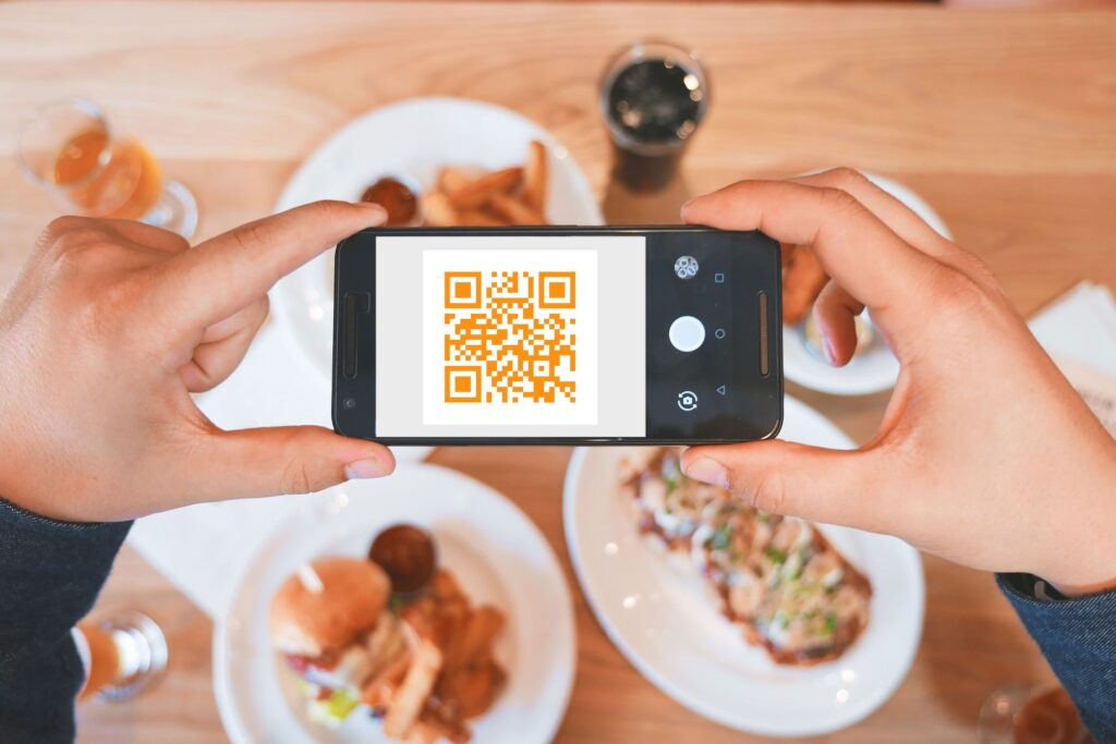 Scan QR code with food background